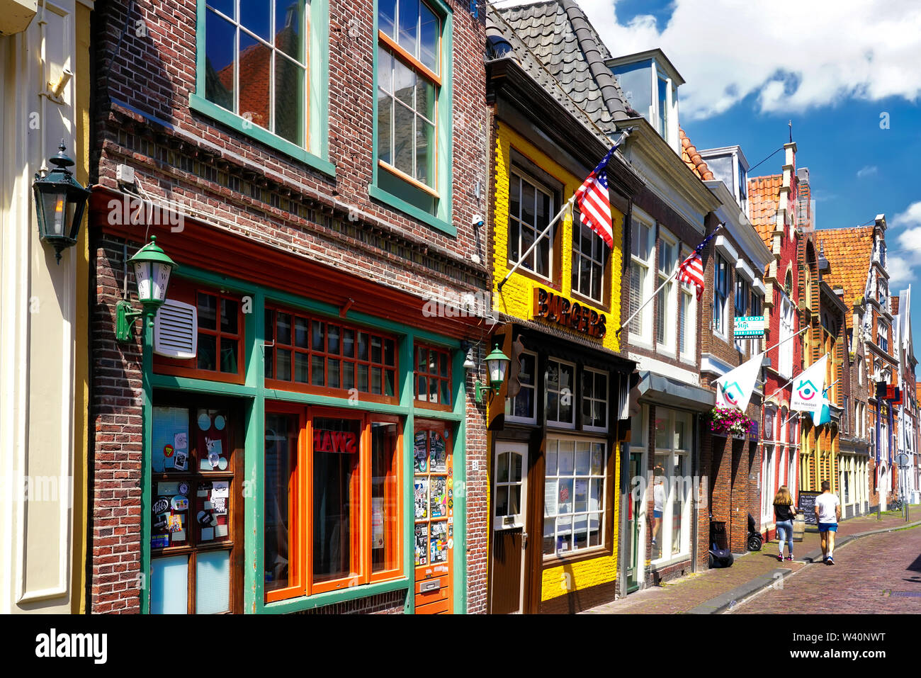 Hoorn, Netherlands, 06/22/2019: Beautiful traditional Dutch houses and stores in the old town of Hoorn - Stock Image