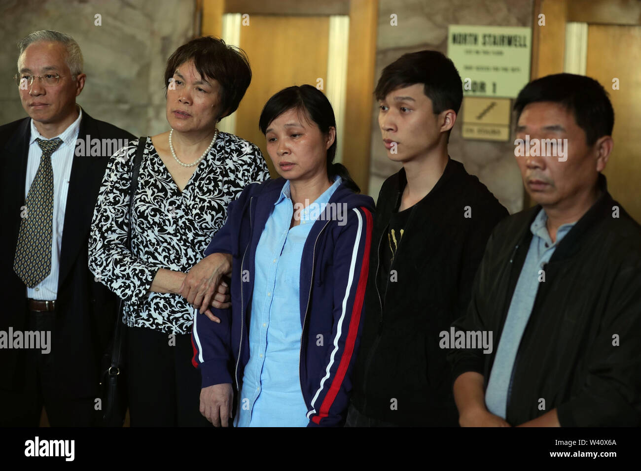 Peoria, USA. 18th July, 2019. Zhang Yingying's mother (C) and father (1st R) attend a press conference after sentencing in Peoria, Illinois, the United States, July 18, 2019. Brendt Christensen, the kidnapper and killer of Chinese scholar Zhang Yingying in 2017, was sentenced on Thursday to life imprisonment without possibility of release, Judge James Shadid announced the verdict in a federal court of Peoria in the U.S. state of Illinois, after the jury failed to reach a unanimous decision on whether he should be sentenced to death or life in prison. Credit: Wang Ping/Xinhua/Alamy Live News - Stock Image