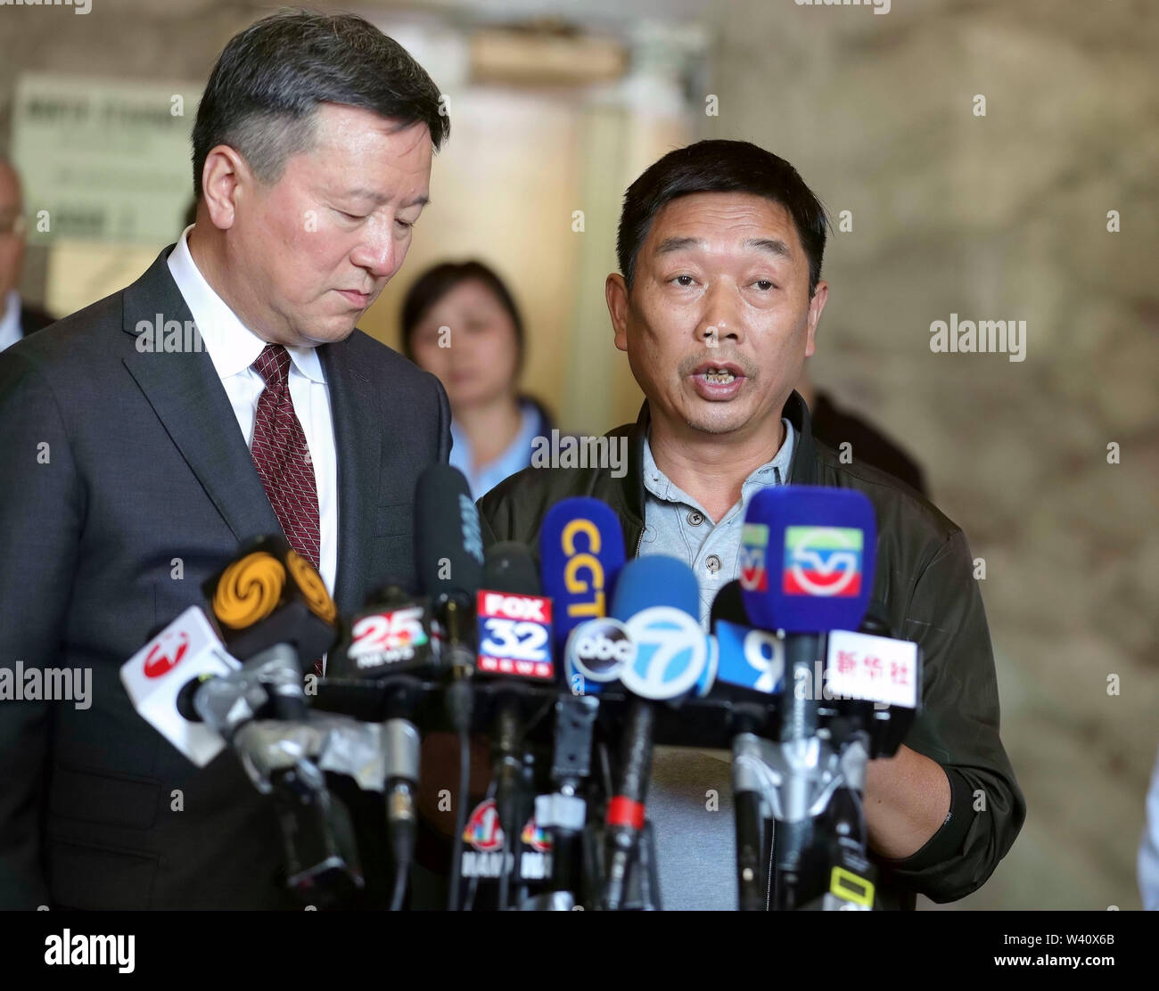 Peoria, USA. 18th July, 2019. Zhang Yingying's father (R) speaks at a press conference after sentencing in Peoria, Illinois, the United States, July 18, 2019. Brendt Christensen, the kidnapper and killer of Chinese scholar Zhang Yingying in 2017, was sentenced on Thursday to life imprisonment without possibility of release, Judge James Shadid announced the verdict in a federal court of Peoria in the U.S. state of Illinois, after the jury failed to reach a unanimous decision on whether he should be sentenced to death or life in prison. Credit: Wang Ping/Xinhua/Alamy Live News - Stock Image
