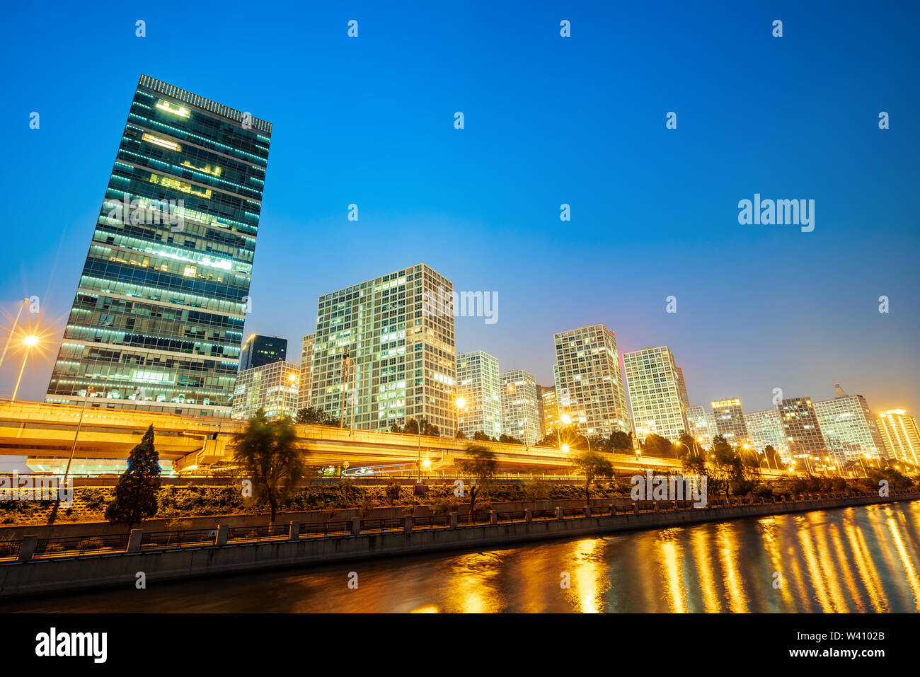 Beijing, China Central Business District city skyline on the Tonghui River. - Stock Image