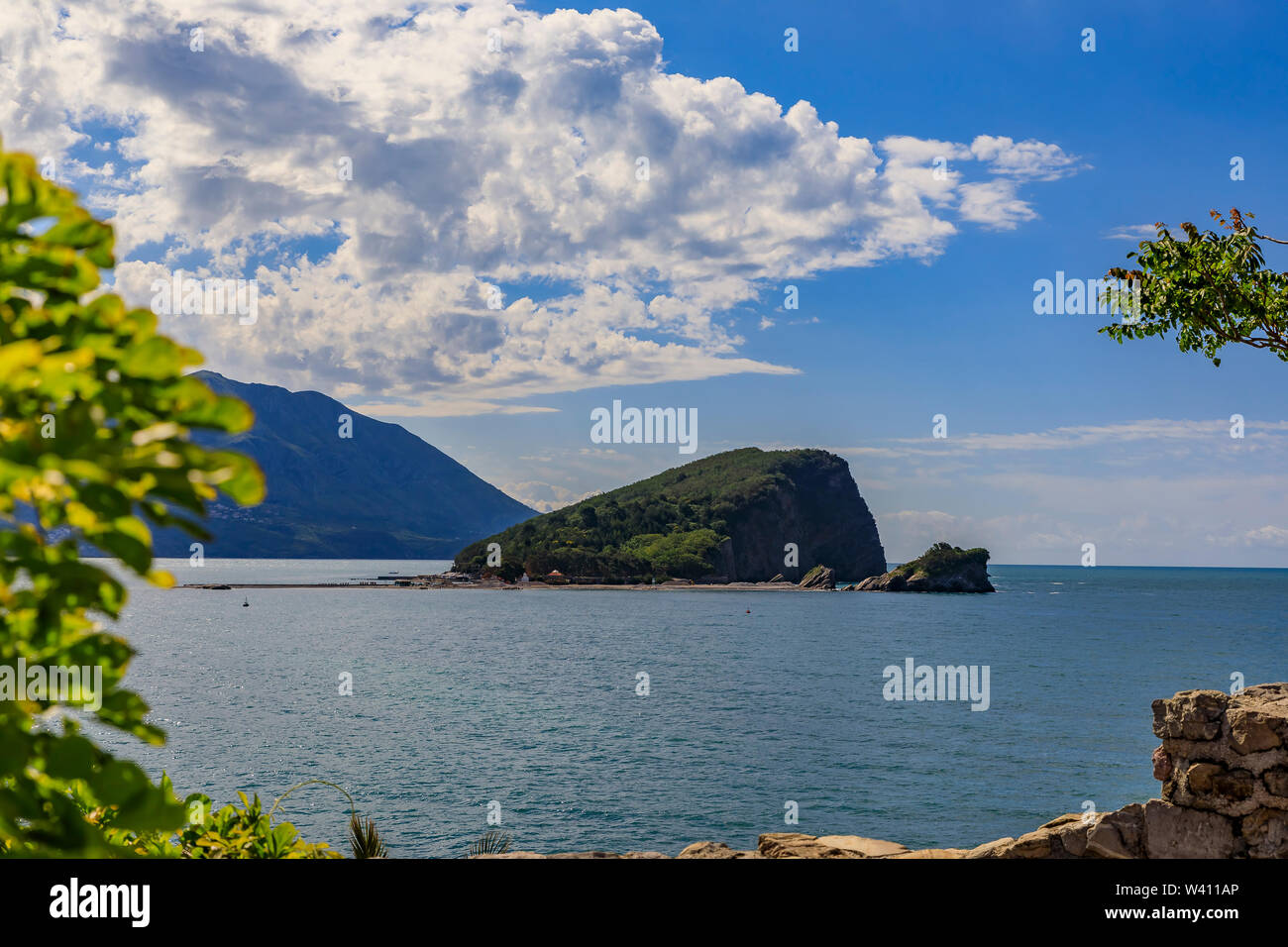 Island of St. Nicholas or Hawaii, small island in the Adriatic sea near Budva Montenegro at sunset - Stock Image