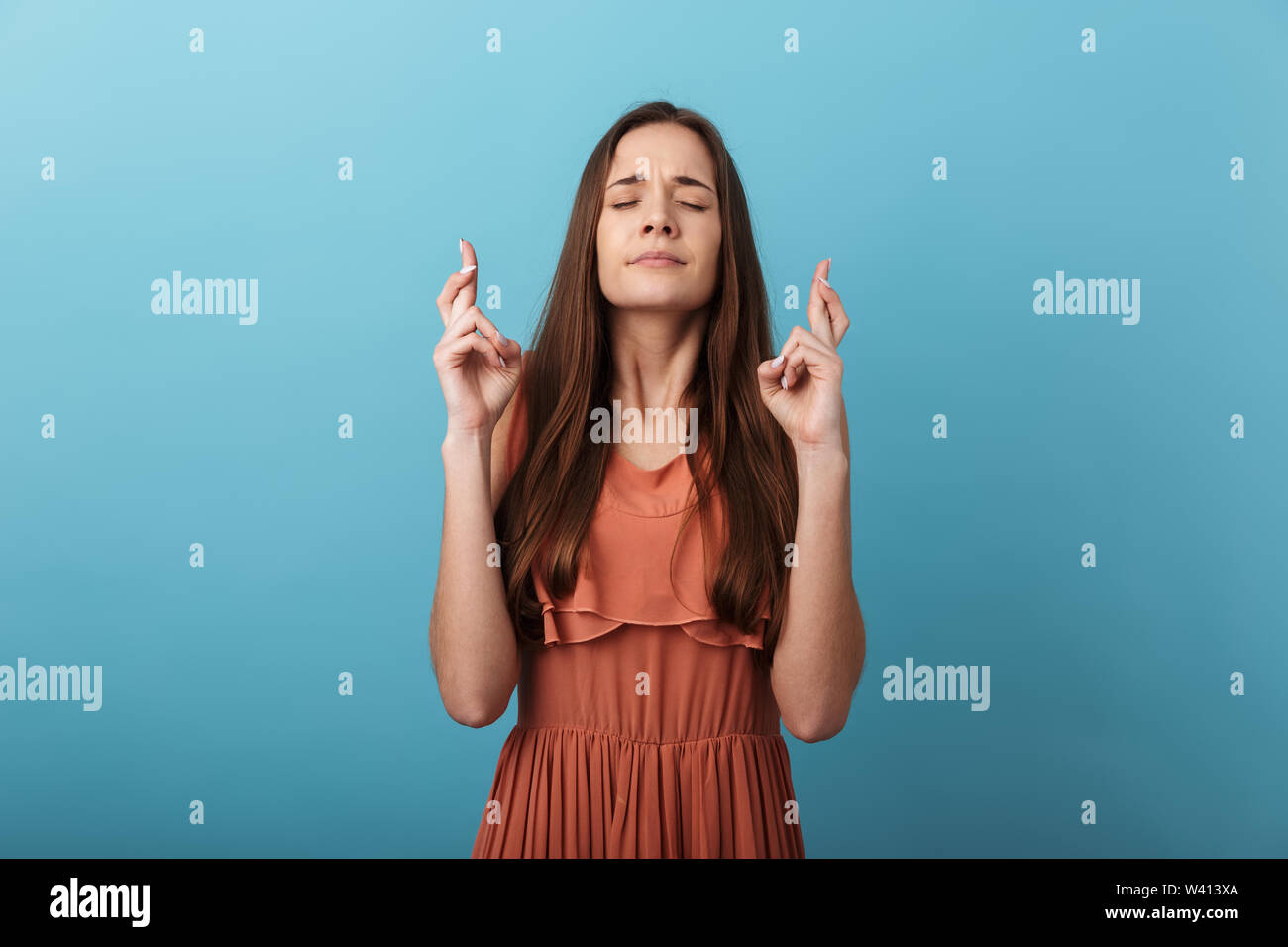 Cute Lovely Young Girl Standing Isolated Over Blue Background