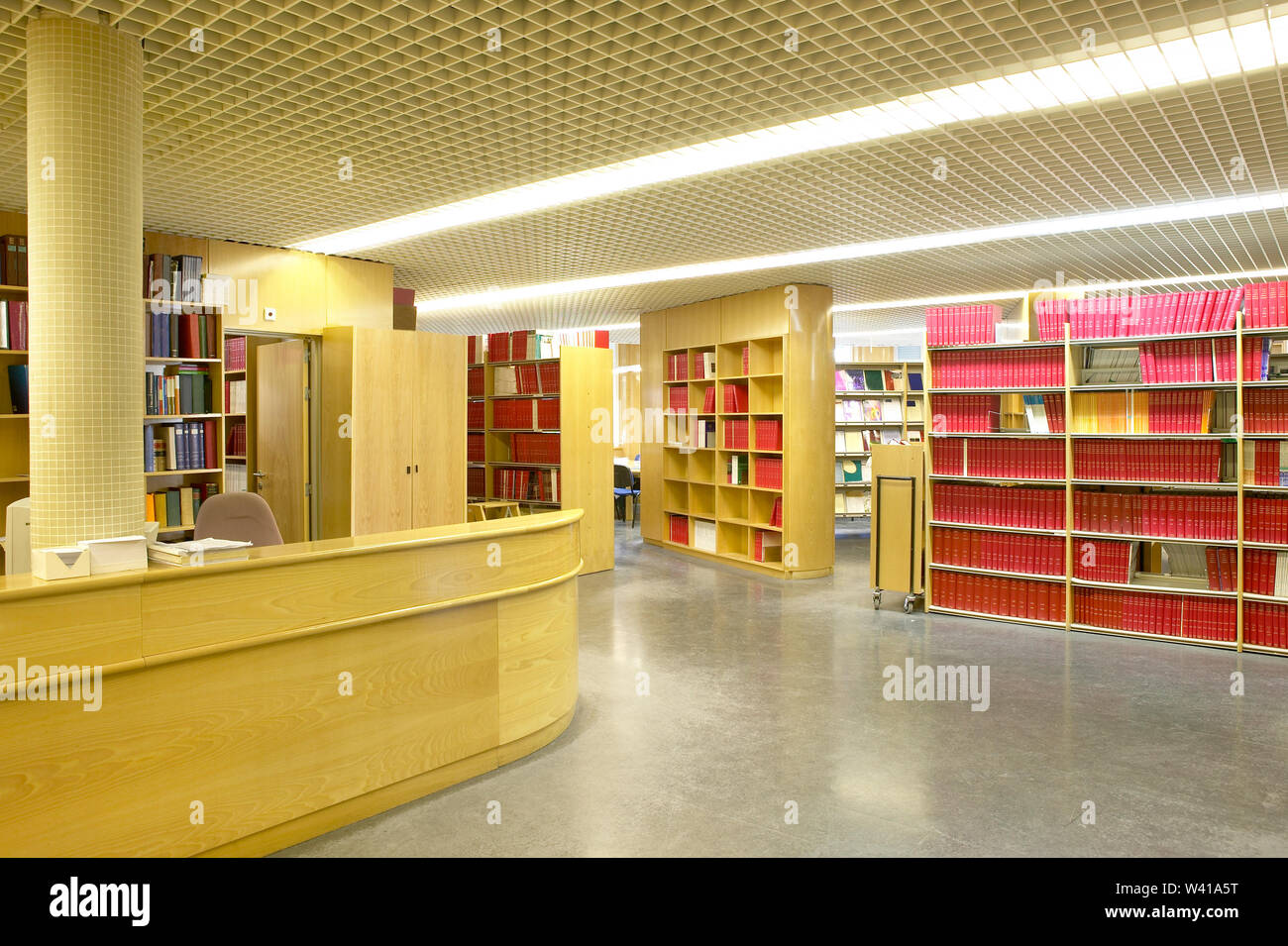 Public Library Interior With Bookshelves And Information