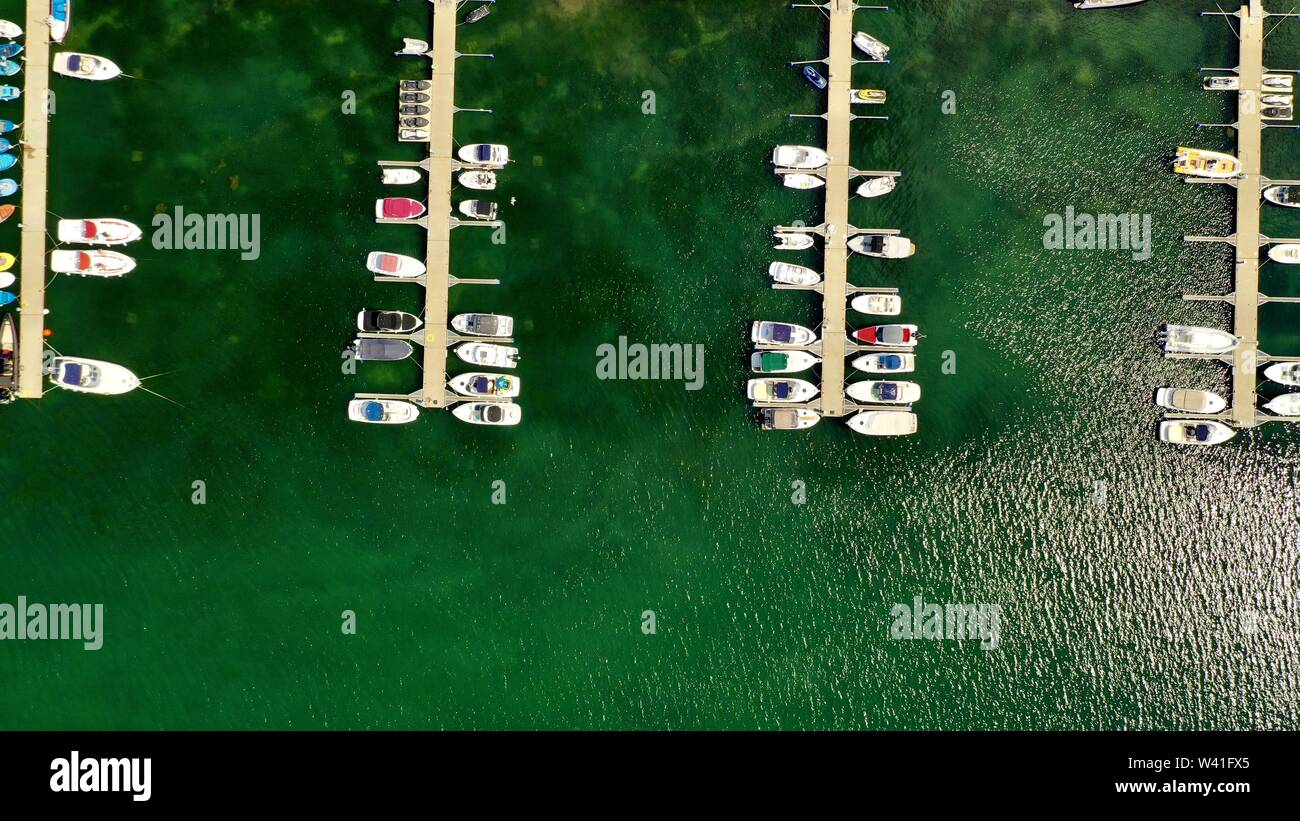 An ariel overhead shot of boats at the dock on a sunny day - Stock Image