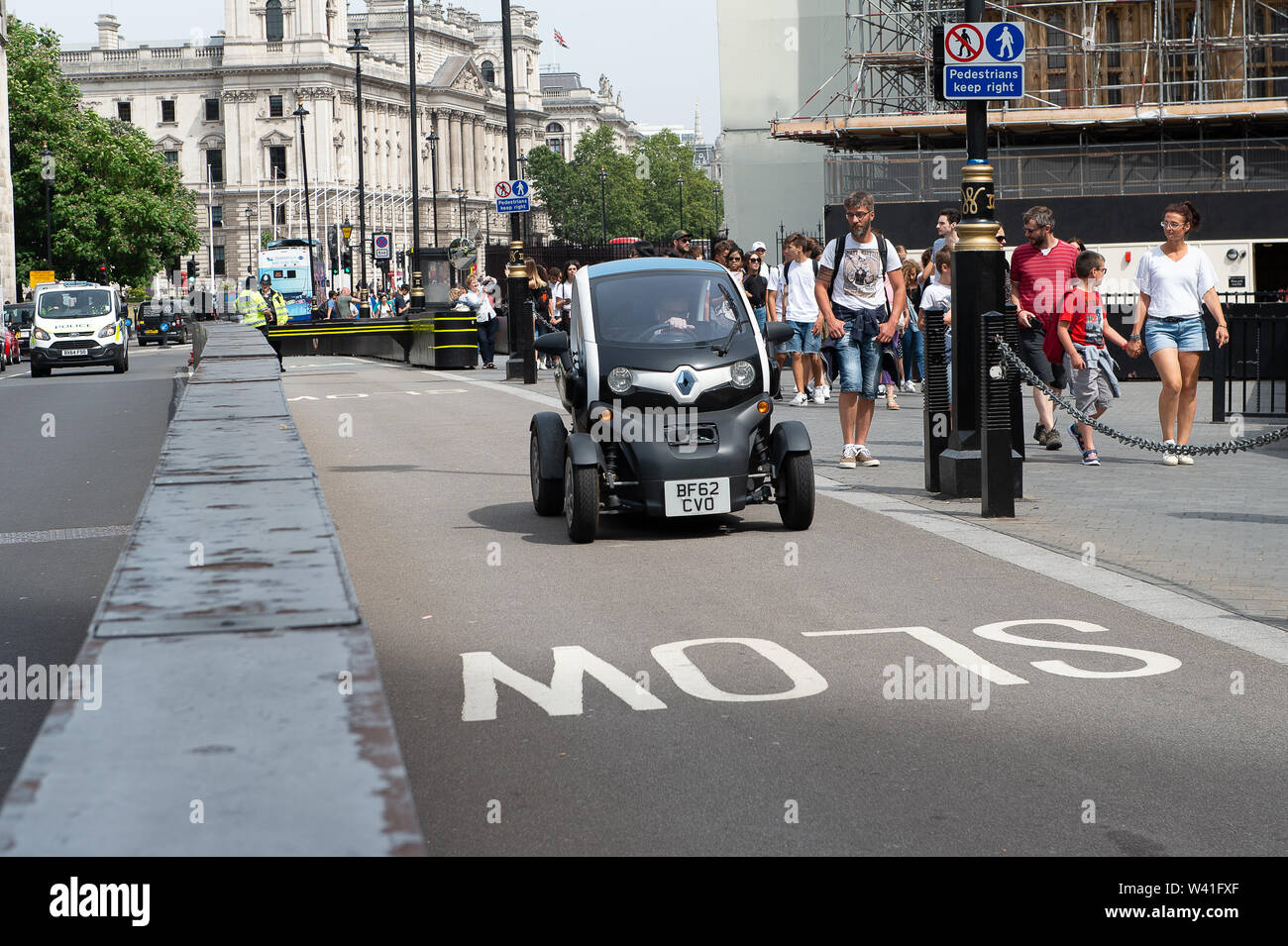 A man drives a small vehicle into the Palace of Westminster, London, UK. 17th July, 2019. A man drives a small four wheel vehicle into the Palace of Westminster along the road marked slow. Credit Maureen McLean/Alamy - Stock Image