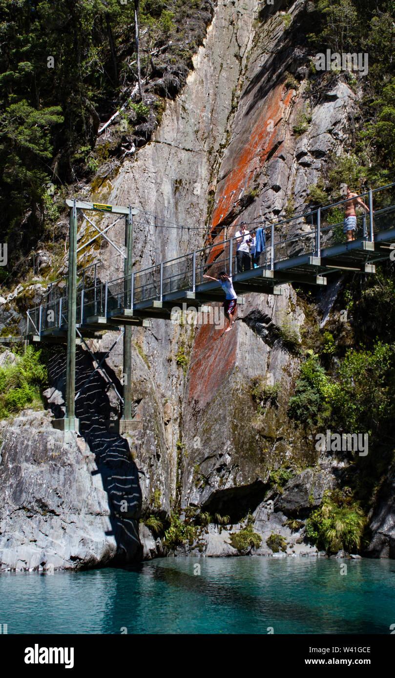 Jumping off the bridge over the Blue Pools, Wanaka New Zealand Stock Photo