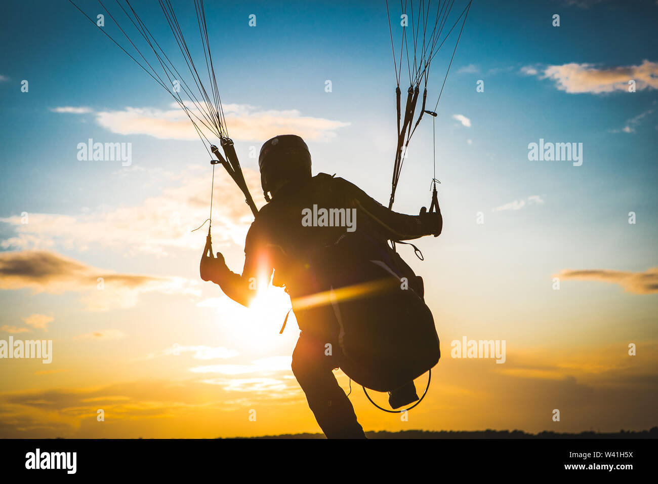Paraglider flying. Sunset. Take off. Top view - Stock Image