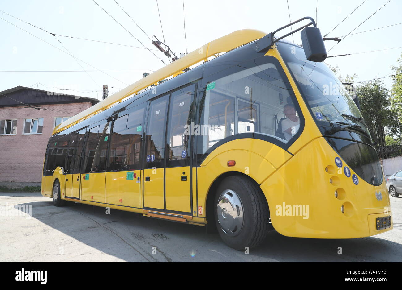 Yekaterinburg, Russia. 19th July, 2019. YEKATERINBURG, RUSSIA - JULY 19, 2019: A Belkommunmash electric bus during a test run along Trolleybus Route 1, from Shchorsa Street to a railway station. The bus, manufactured by Belarus' Belkommunmash Company, was displayed at the 2019 Innoprom exhibition. Donat Sorokin/TASS Credit: ITAR-TASS News Agency/Alamy Live News - Stock Image