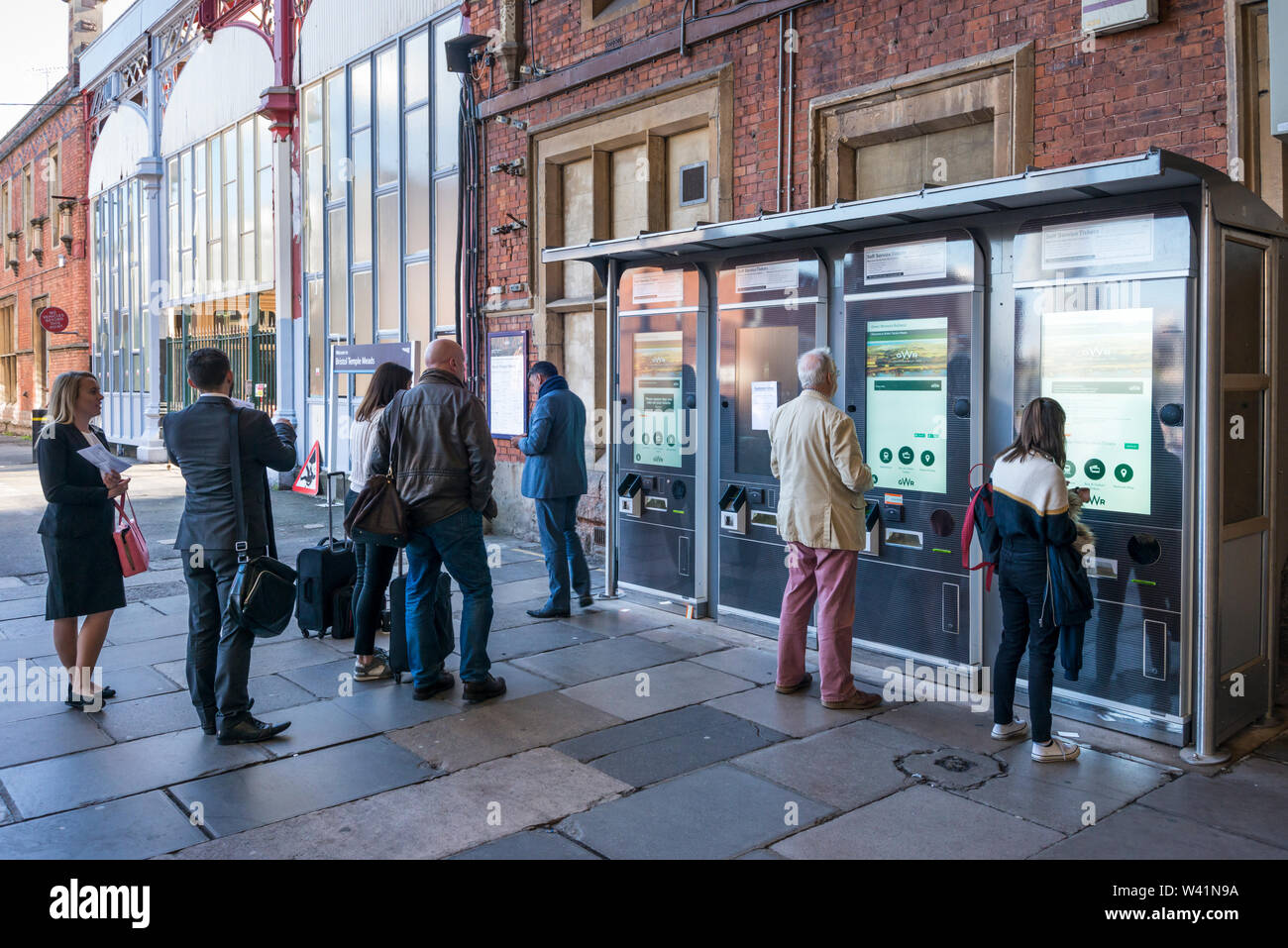 People buying train tickets from self service ticket machine, Temple Meads Rialway Station, Bristol Stock Photo