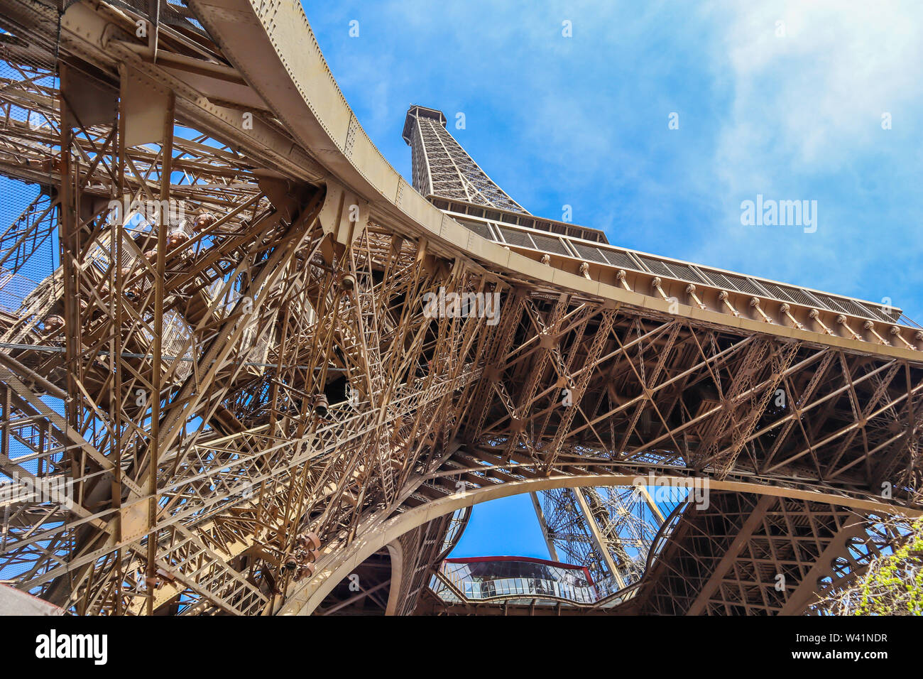 Eiffel Tower against blue sky with clouds in Paris, France. April 2019 - Stock Image