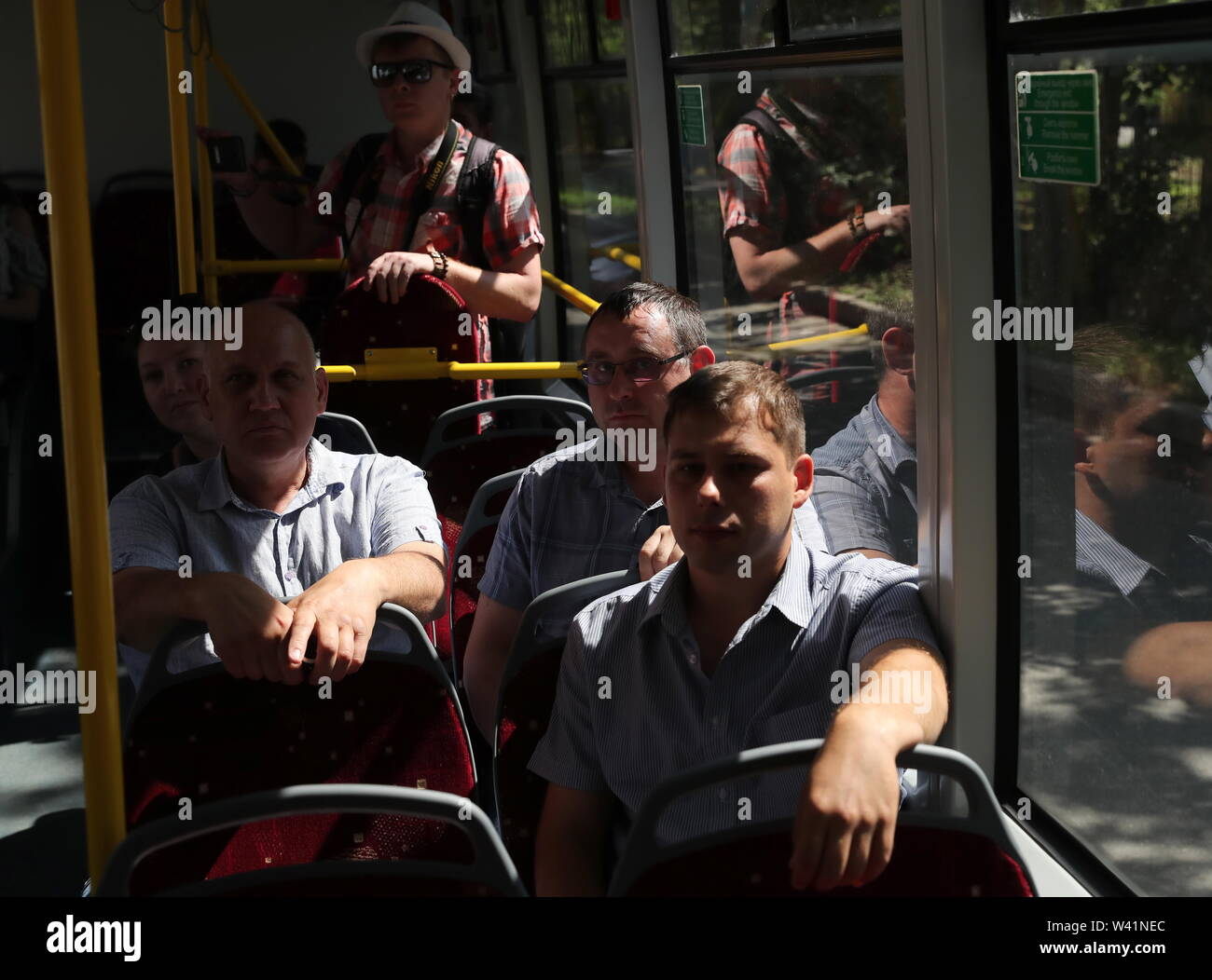 Yekaterinburg, Russia. 19th July, 2019. YEKATERINBURG, RUSSIA - JULY 19, 2019: Passengers in a Belkommunmash electric bus during a test run along Trolleybus Route 1, from Shchorsa Street to a railway station. The bus, manufactured by Belarus' Belkommunmash Company, was displayed at the 2019 Innoprom exhibition. Donat Sorokin/TASS Credit: ITAR-TASS News Agency/Alamy Live News - Stock Image