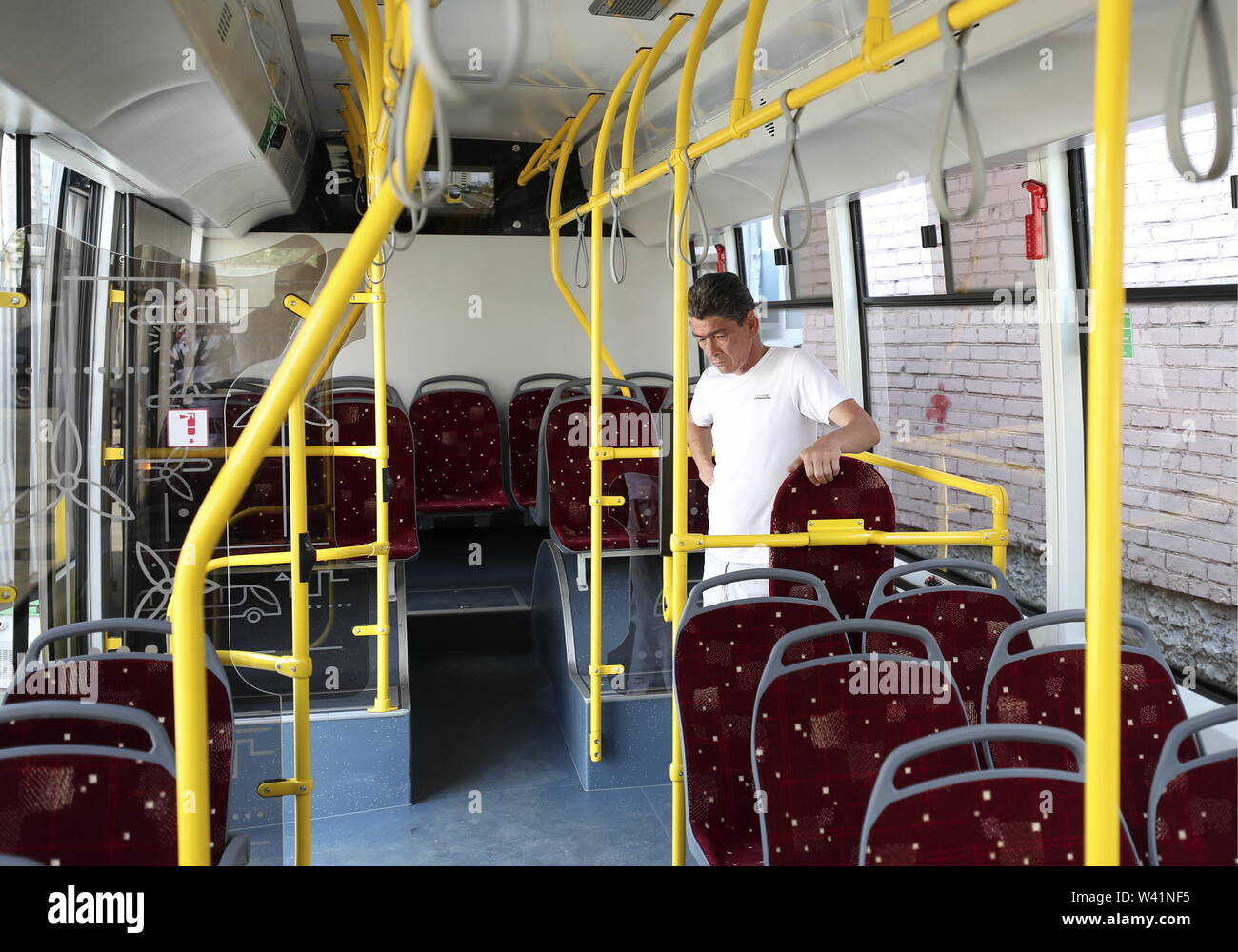 Yekaterinburg, Russia. 19th July, 2019. YEKATERINBURG, RUSSIA - JULY 19, 2019: A passenger in a Belkommunmash electric bus during a test run along Trolleybus Route 1, from Shchorsa Street to a railway station. The bus, manufactured by Belarus' Belkommunmash Company, was displayed at the 2019 Innoprom exhibition. Donat Sorokin/TASS Credit: ITAR-TASS News Agency/Alamy Live News - Stock Image