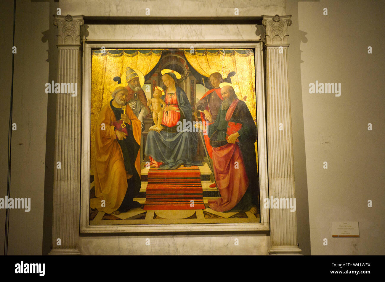 Italy, Tuscany, Lucca, San Martino cathedral, Virgin and Child with Saints Peter, Clement, Sebastian and Paul. 1479, tempera on panel by Ghirlandaio Stock Photo