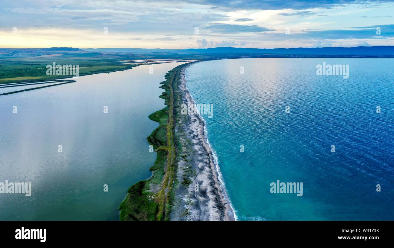An aerial shot of a long narrow shore in the middle of the sea - Stock Image
