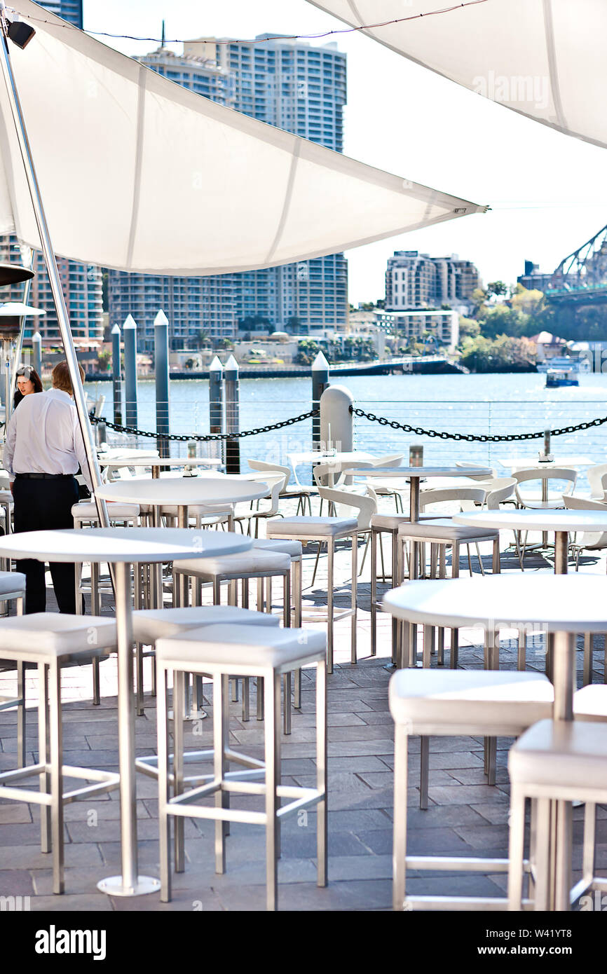 Modern waterside patio area or restaurant in the Brisbane City, Queensland, Australia. - Stock Image