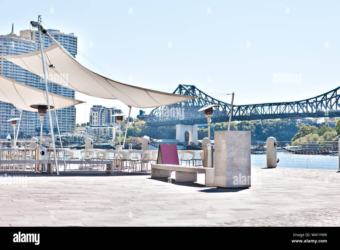 Modern outside dining area from riverside of a modern Brisbane City  , Queensland, Australia. - Stock Image
