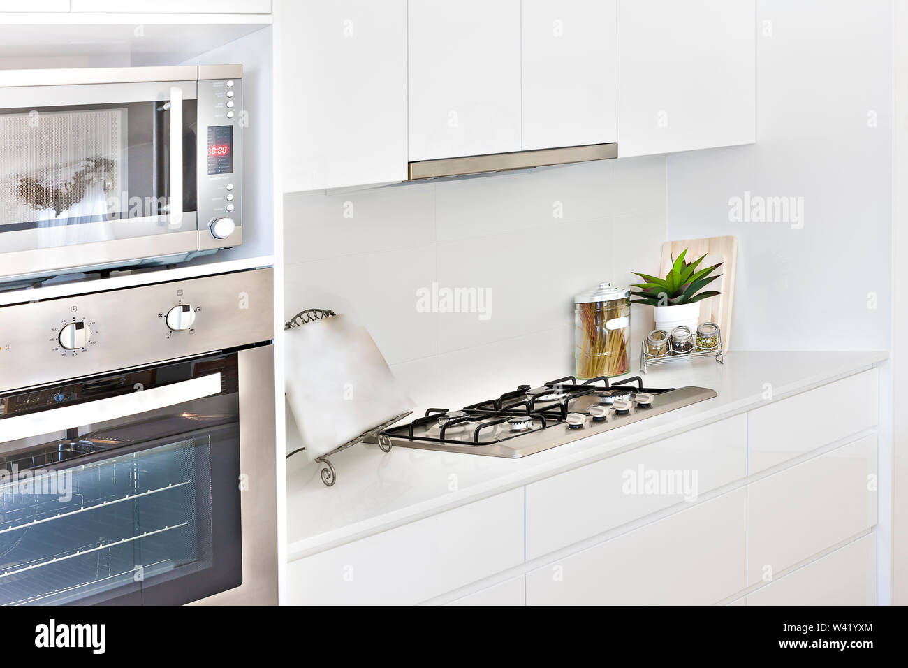 Modern Kitchen tools with white walls and oven, gas cooker also