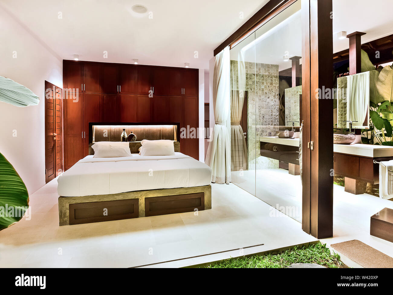 Luxury bedroom with the natural decor design including lawn