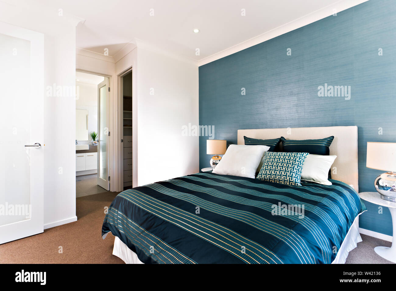 Close up of a blue decorative bedroom with an entrance and