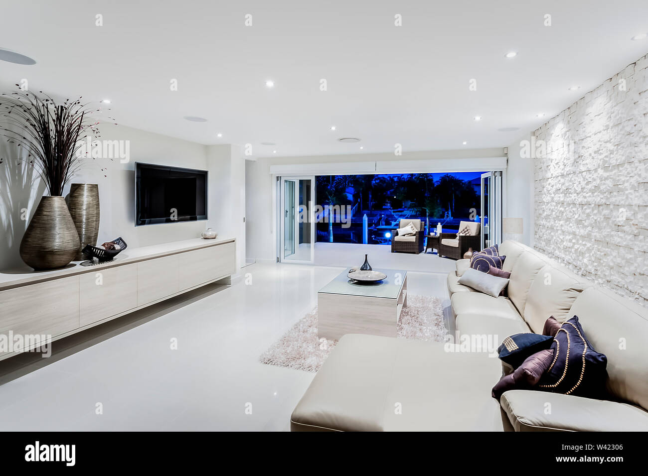 Modern Living Room At Night With Sofas And Pillows Next To ...