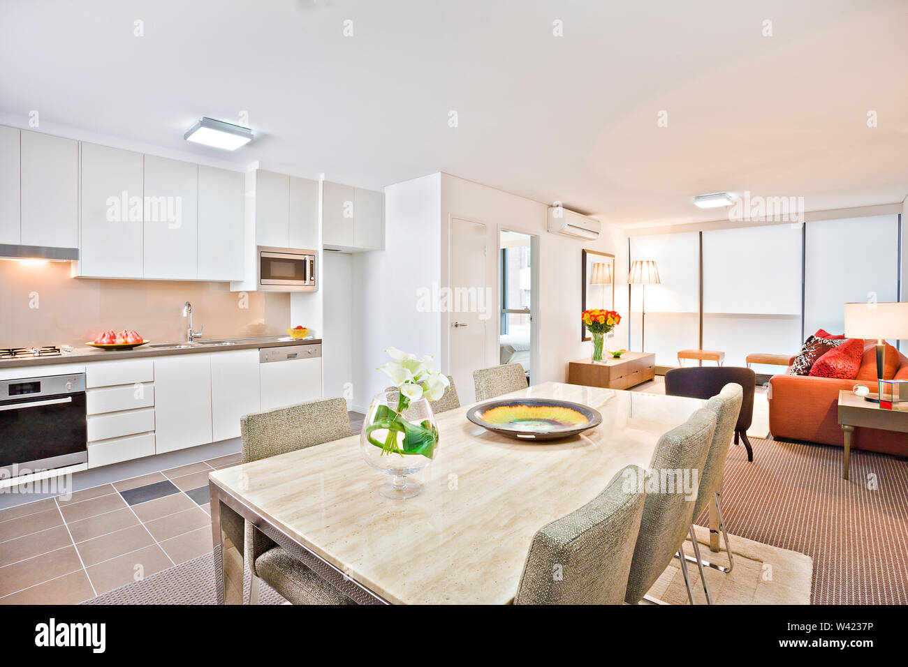 Luxury kitchen with modern table and sofa, wash basin also gas