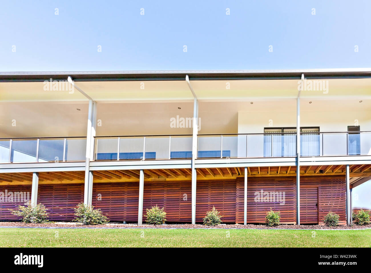 Luxurious House Design And Colors With Grass Ground House Walls Have Made With Woods Sky Is Very Clear With Blue Color Daytime Scene With Sun Light Stock Photo Alamy