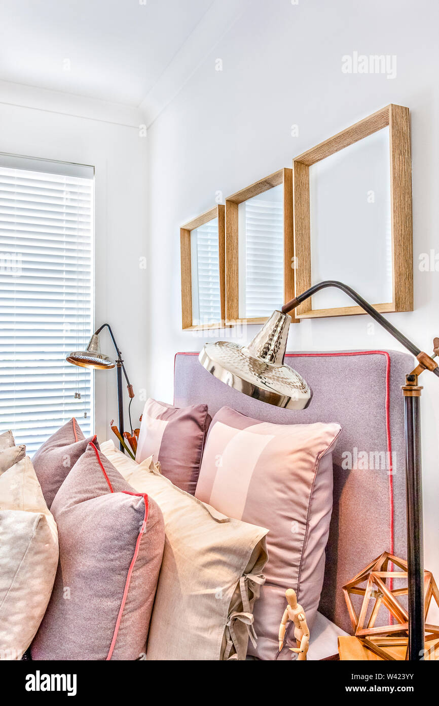 Luxurious Bedroom With Wooden Fancy Items And Pillows Close Up From The Side With Silver Color Table Lamps Beside A Closed Window Stock Photo Alamy