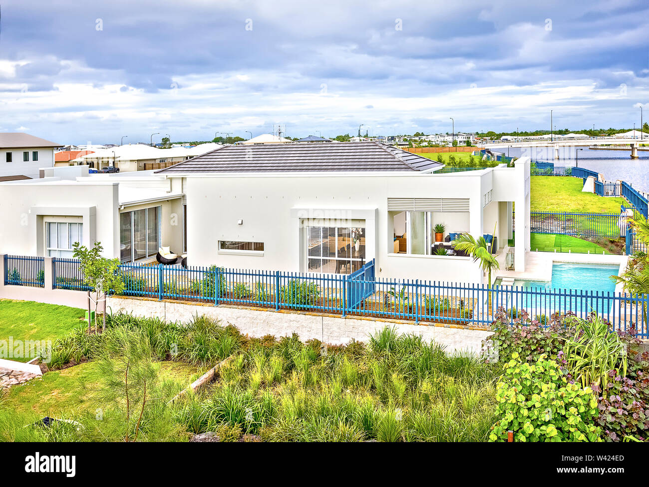Luxury Home Design And Natural Garden Near Lake Swimming Pool Near Metal Fence Sky Is Colorful And Some Clouds Have Beautiful Flowers Also Plants Ar Stock Photo Alamy