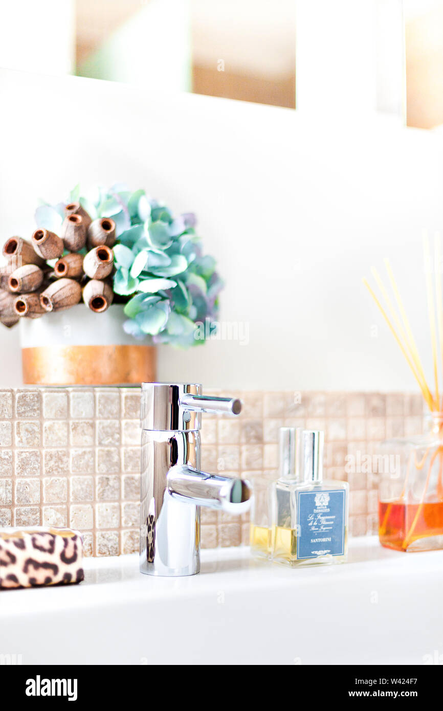 Silver Tap With Aromatic Scent Diffuser Bottle In A Modern Bathroom With Sticks In It Next To Fancy Flower Vase Near To The Wall With Tiles Stock Photo Alamy