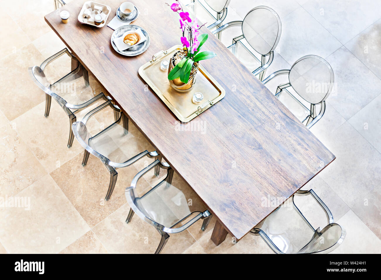 Wooden Dining Table Above View With Plastic Chairs The Golf Color Plate And Vase Holding A Purple Flowering Plants With Green Leaves Beside Tea Cups Stock Photo Alamy