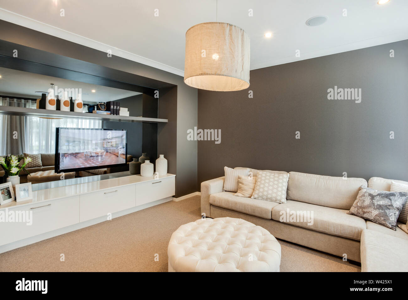 Tremendous A Chic Tv Room With An Elegant And Stylish Angled Sofa And A Ibusinesslaw Wood Chair Design Ideas Ibusinesslaworg
