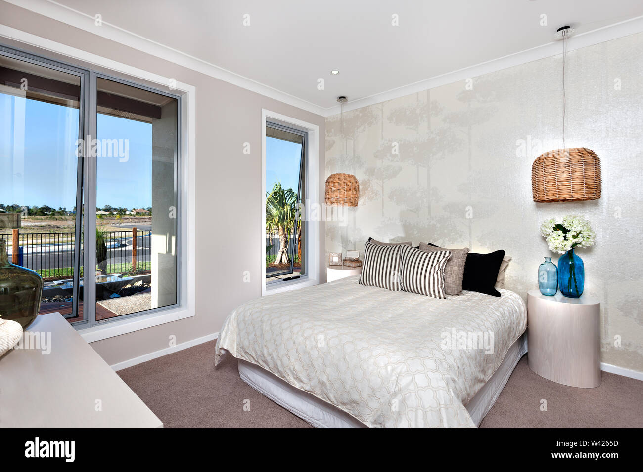 Bedroom including hanging lamp cover with rattan filter or ...