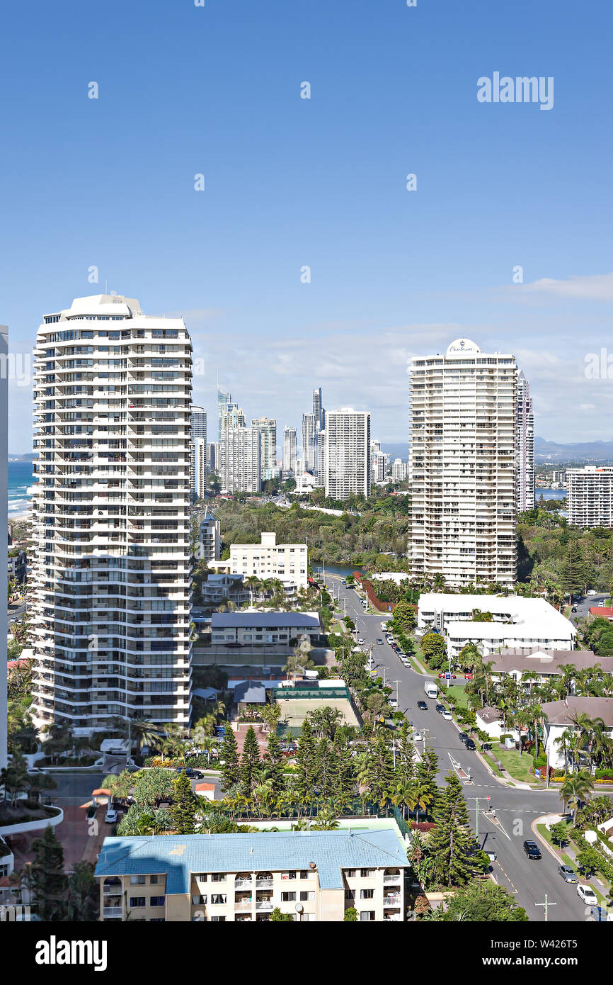 Photograph of urban skyscrapers with surrounding buildings and roads - Stock Image