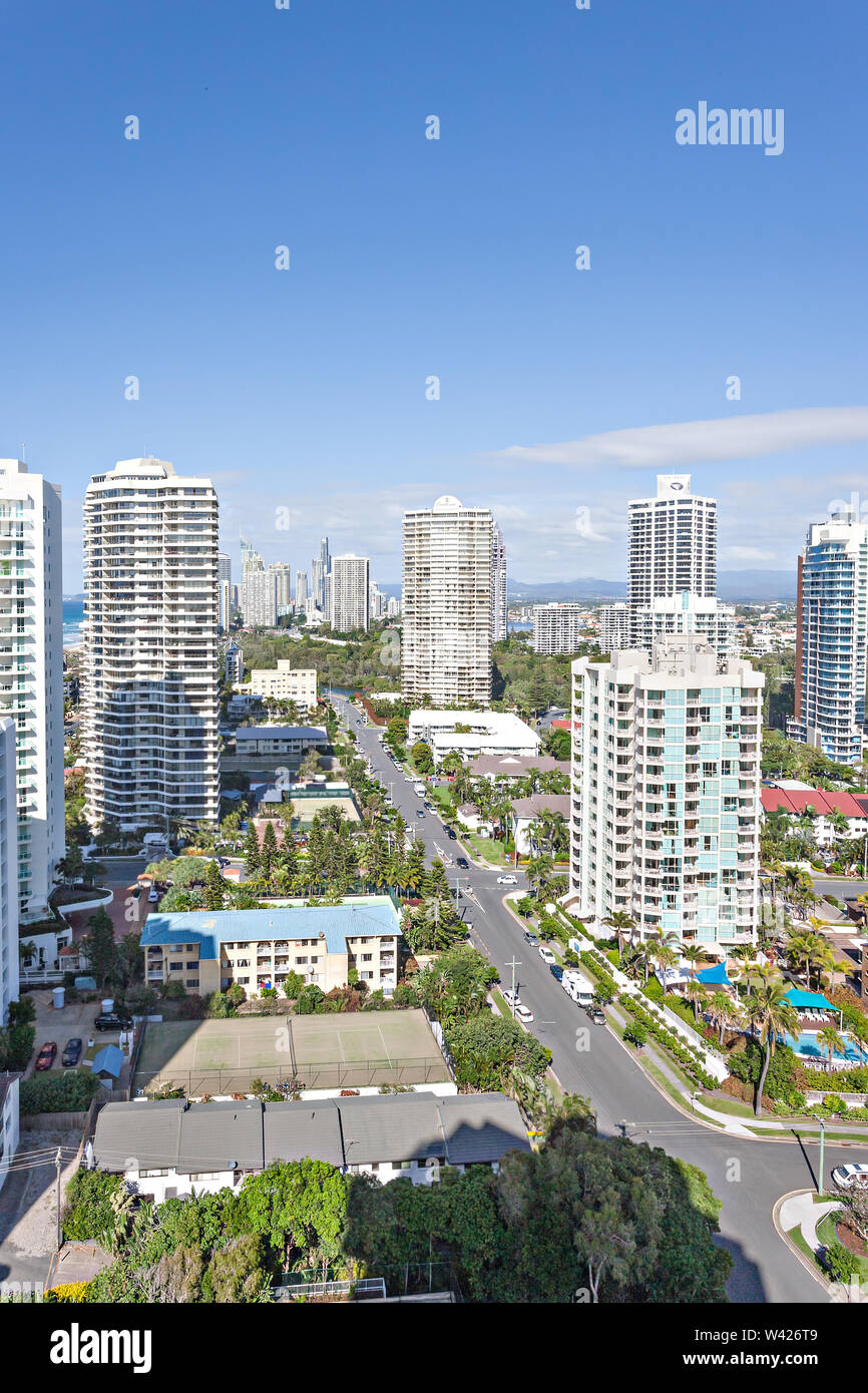 Skyscrapers in a city surrounded by small buildings and roads - Stock Image