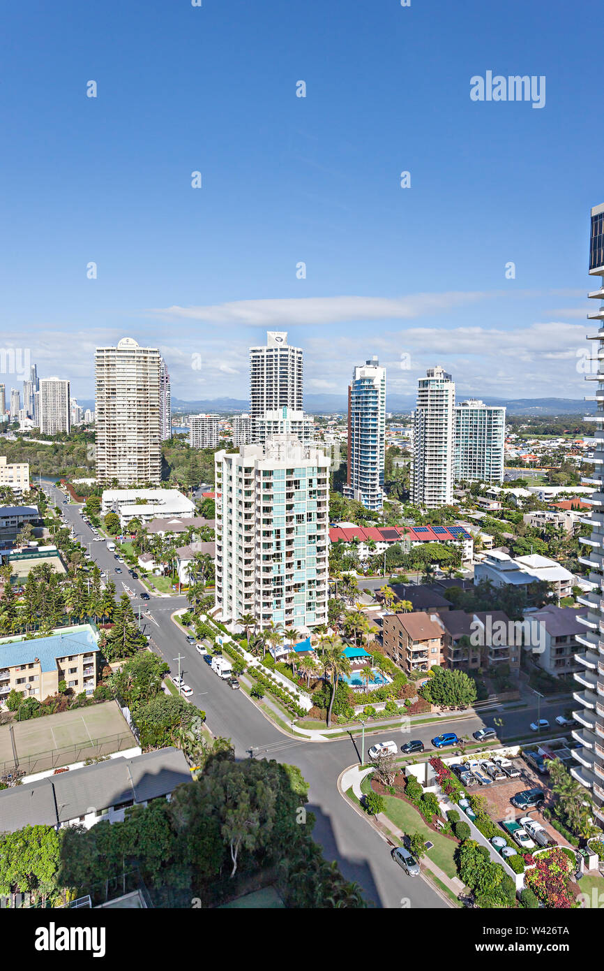 An urban establishment with skyscrapers, homes, and roads - Stock Image
