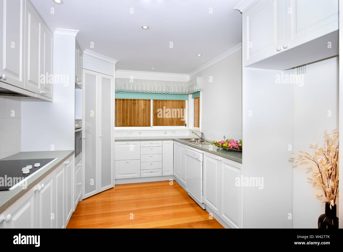 Empty White Kitchen With Wooden Floor Electric Stove Some