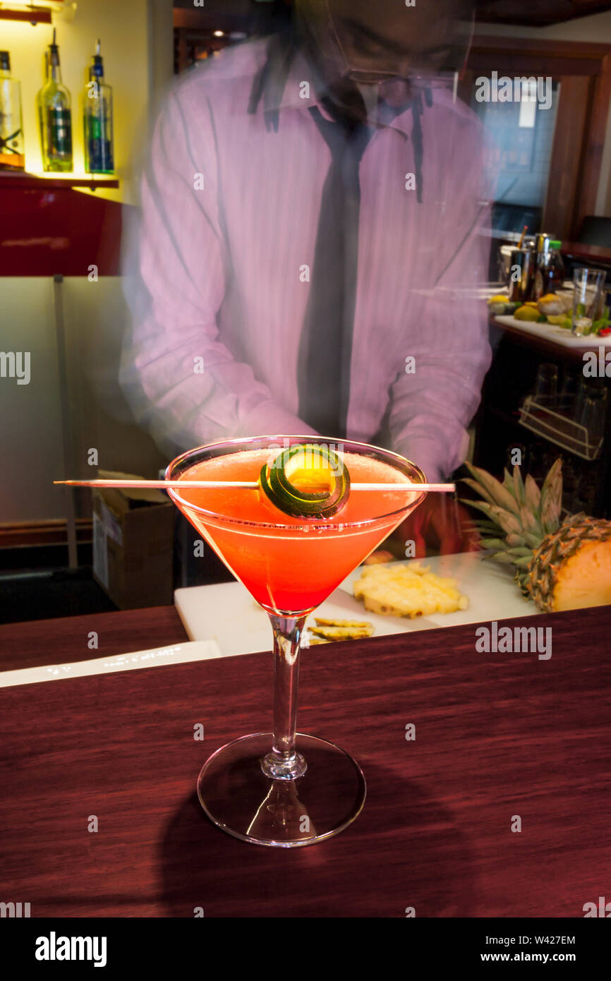 Chef making a fruit juice, inside at a hotel, colorized photograph including perfect lights, very tasty cool drink of luxury restaurant. - Stock Image