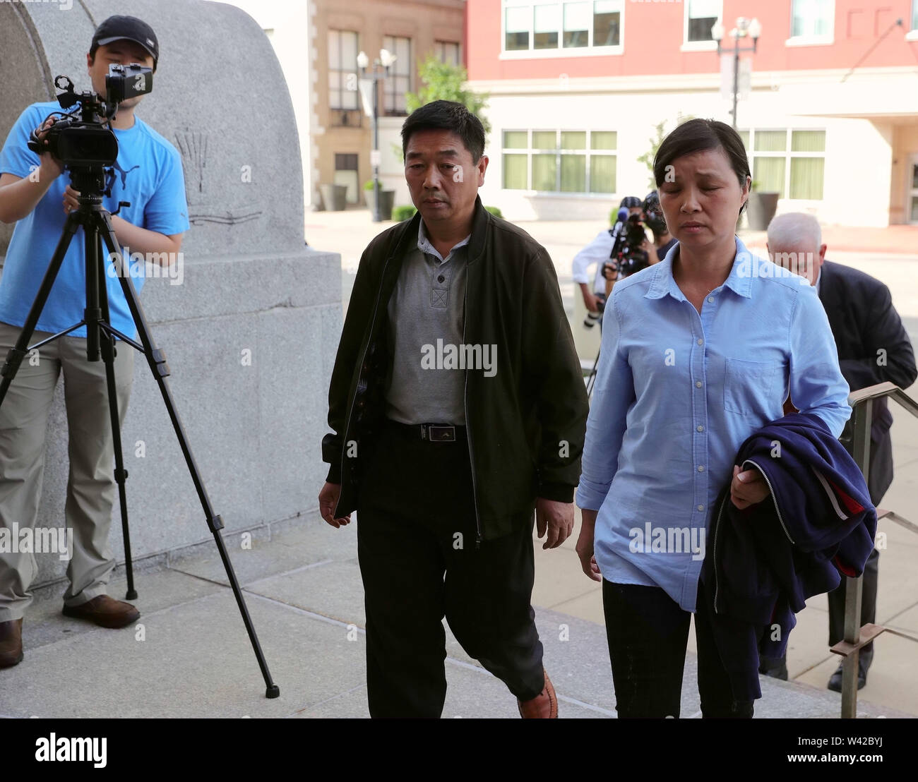 Beijing, USA. 18th July, 2019. Family members of Chinese scholar Zhang Yingying head to a federal courthouse building in Peoria, Illinois, the United States, July 18, 2019. Credit: Wang Ping/Xinhua/Alamy Live News - Stock Image