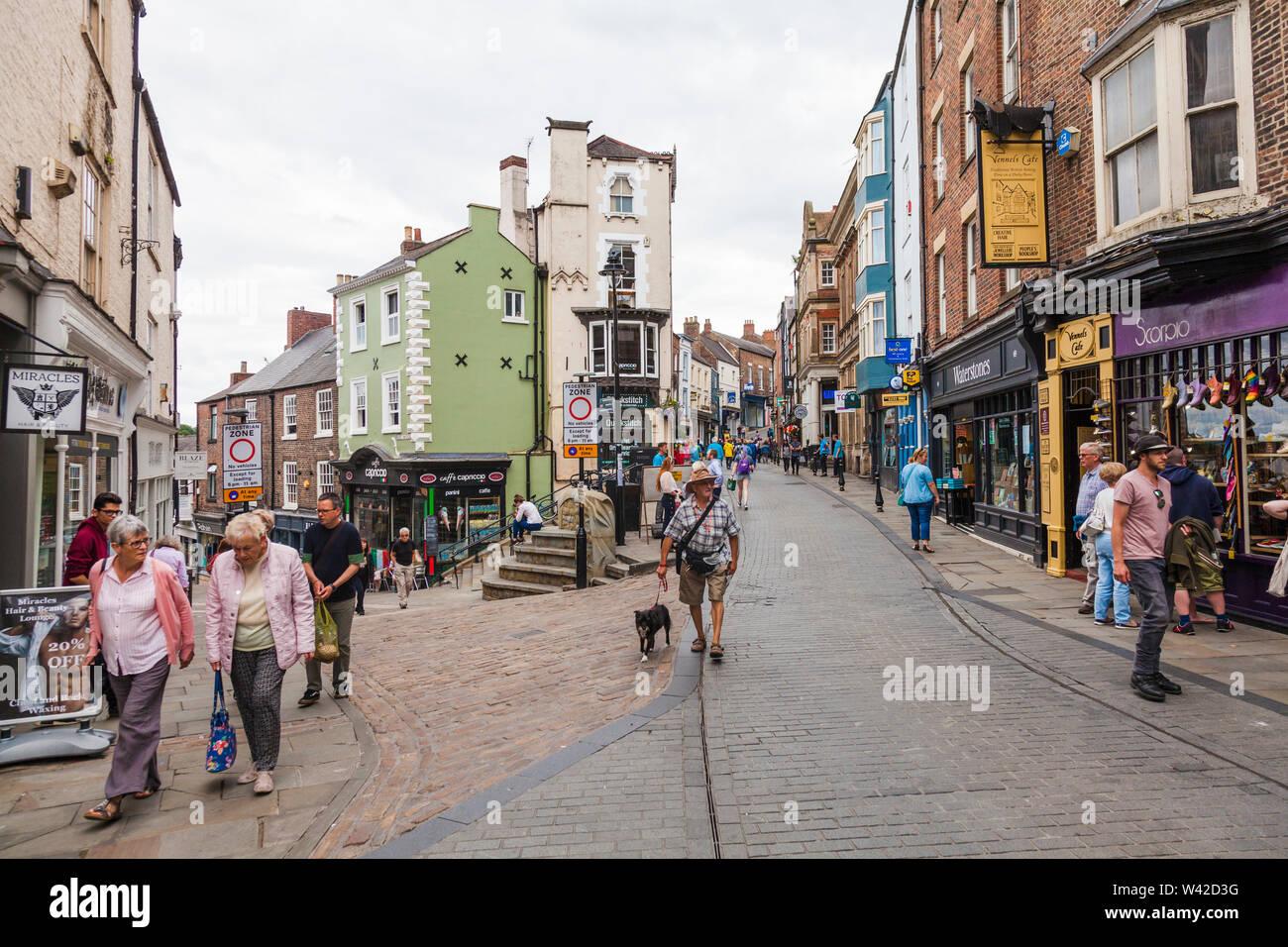 Street scene at the junction of Saddler Street and Elvet Bridge in Durham,England,UK - Stock Image