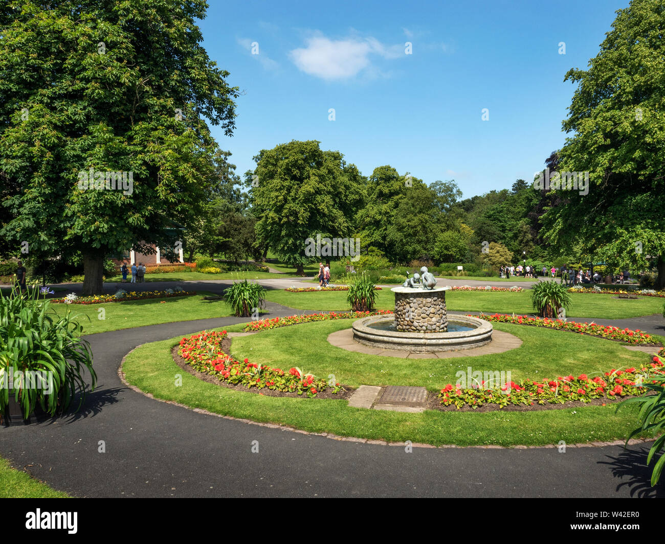Valley Gardens in summer with the Cherub Fountain as a centrepiece Harrogate North Yorkshire England Stock Photo