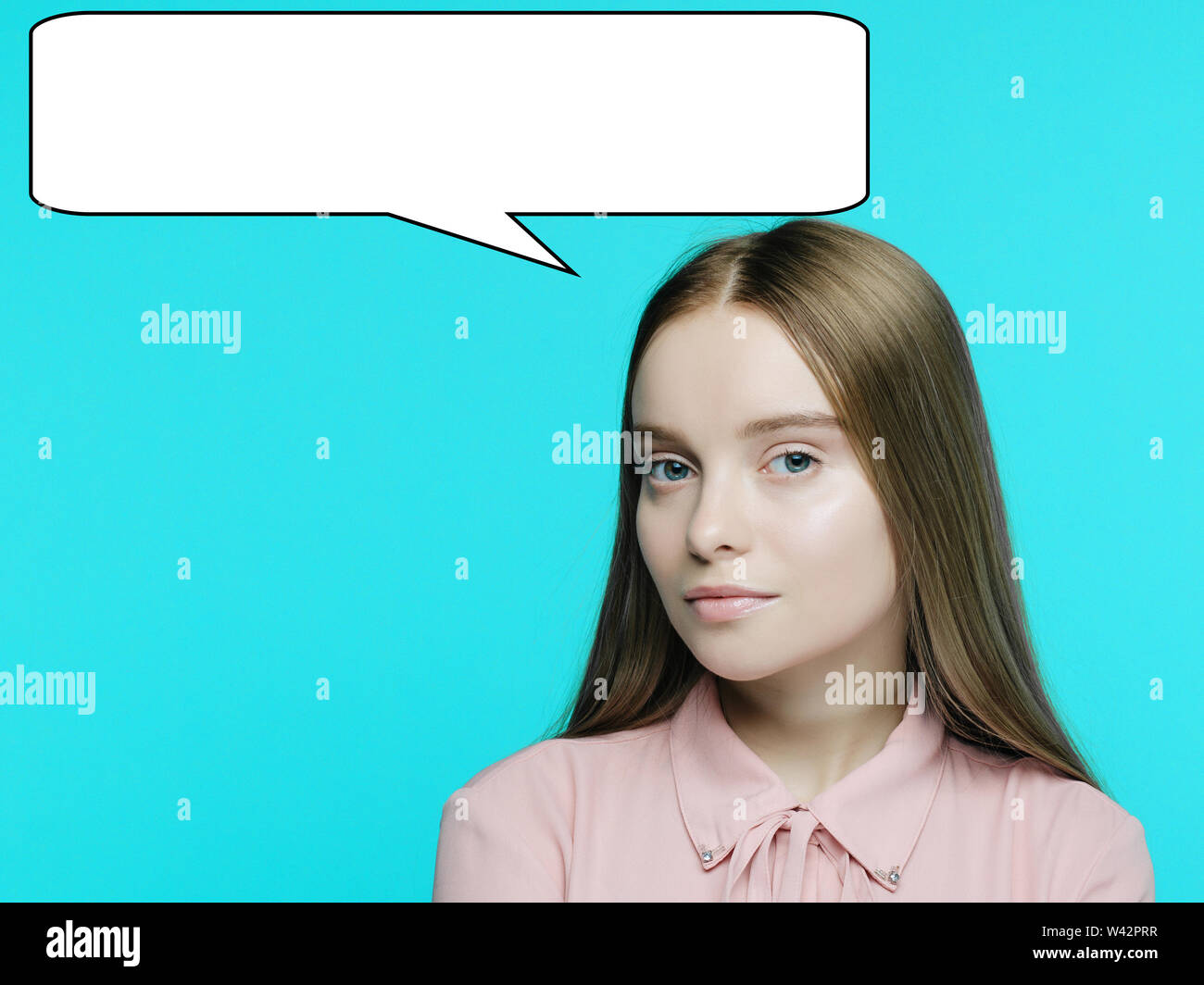 Portrait of a young pensive girl with a babble talk over her head on cyan background. - image Stock Photo