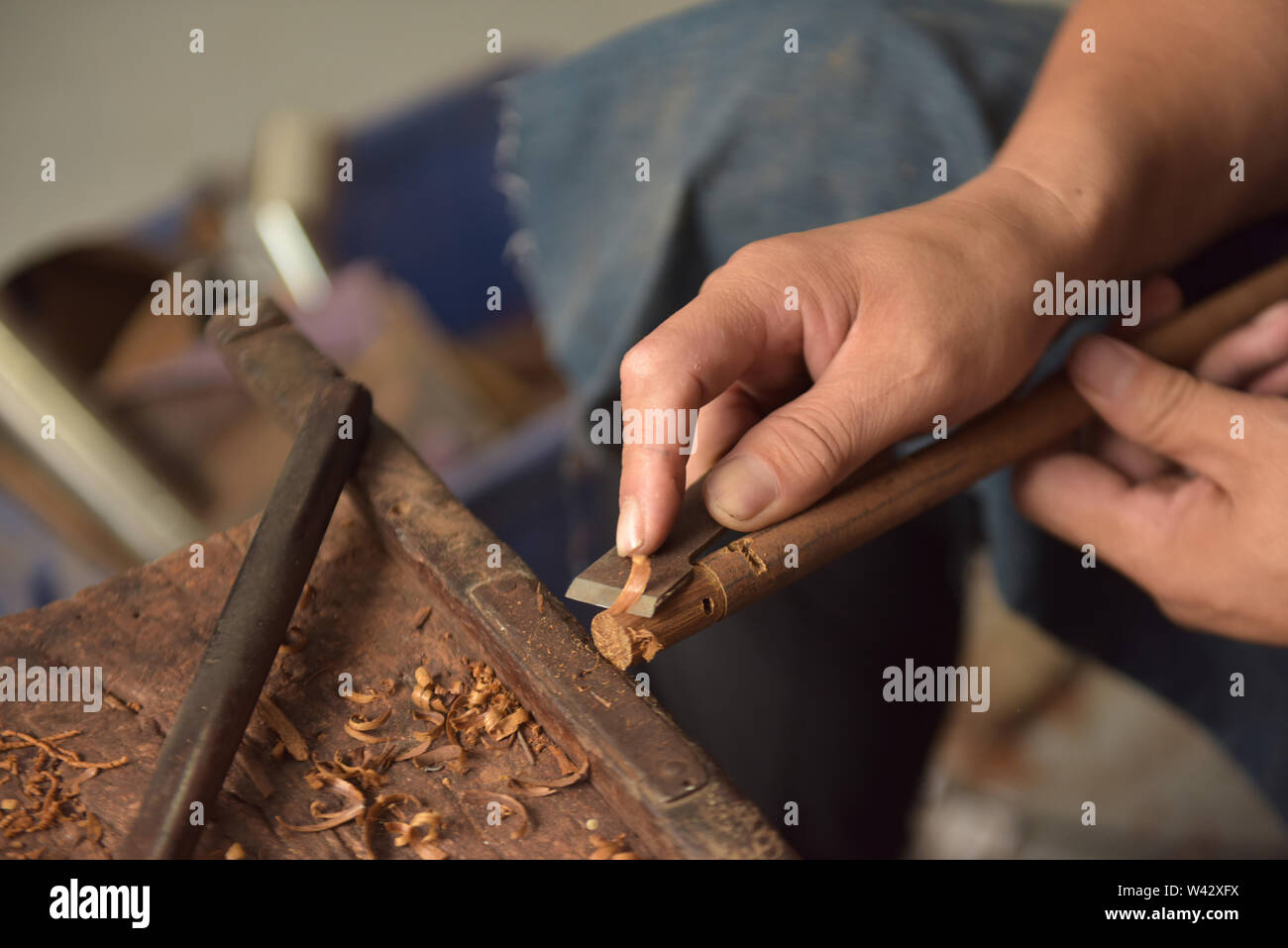 (190719) -- QINGDAO, July 19, 2019 (Xinhua) -- Sun Lianyong, a steelyard craftsman, makes the beam of a steelyard at his workshop in Jinkou Town of Jimo District in Qingdao, east China's Shandong Province, July 19, 2019. Steelyard, a traditional weighing instrument with a long history, used to be popular for its low cost and good portability. In the early 1990s, there used to be more than 30 steelyard workshops in Jimo as the development of market economy pushed up people's demand for steelyards.   The 49-year-old craftsman Sun Lianyong is an inheritor of traditional steelyard making technique - Stock Image