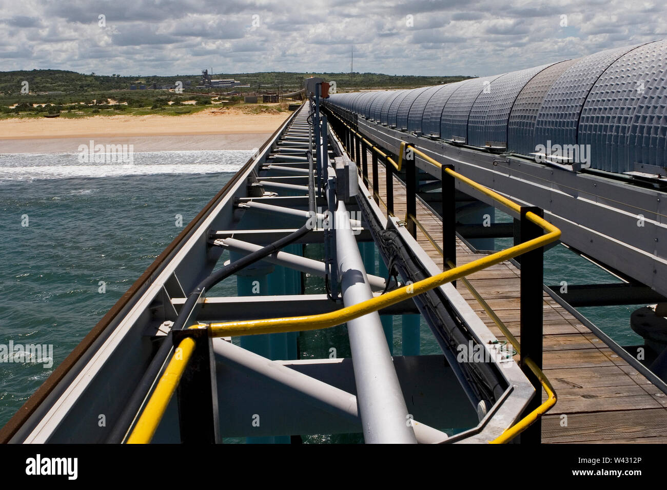 Mining, managing & transporting of titanium mineral sands. 400m long jetty supporting end of 2.4km overland covered conveyor and pedestrian walkway. Stock Photo