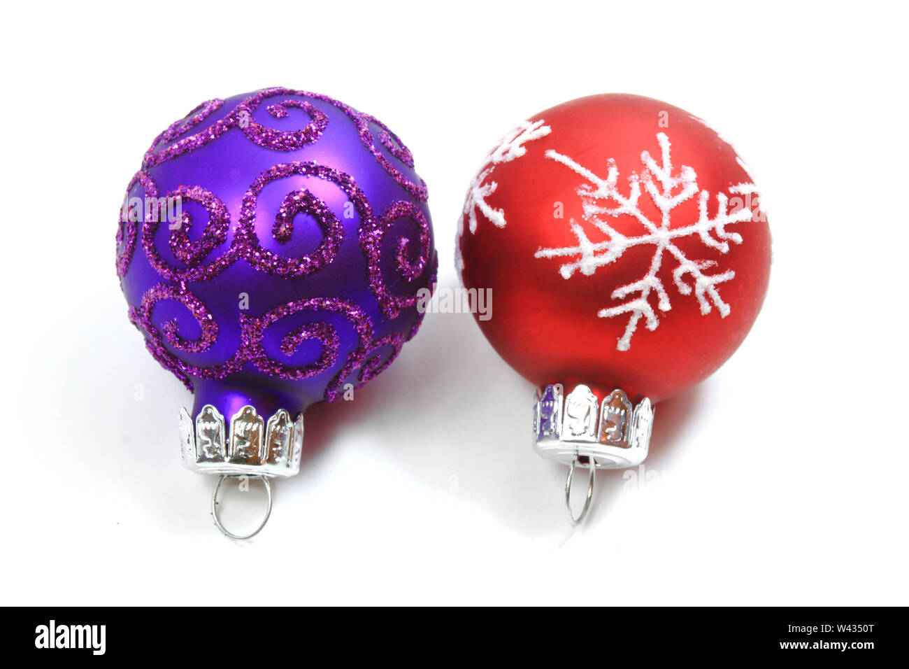 Christmas baubles - red and purple isolated over white Stock Photo