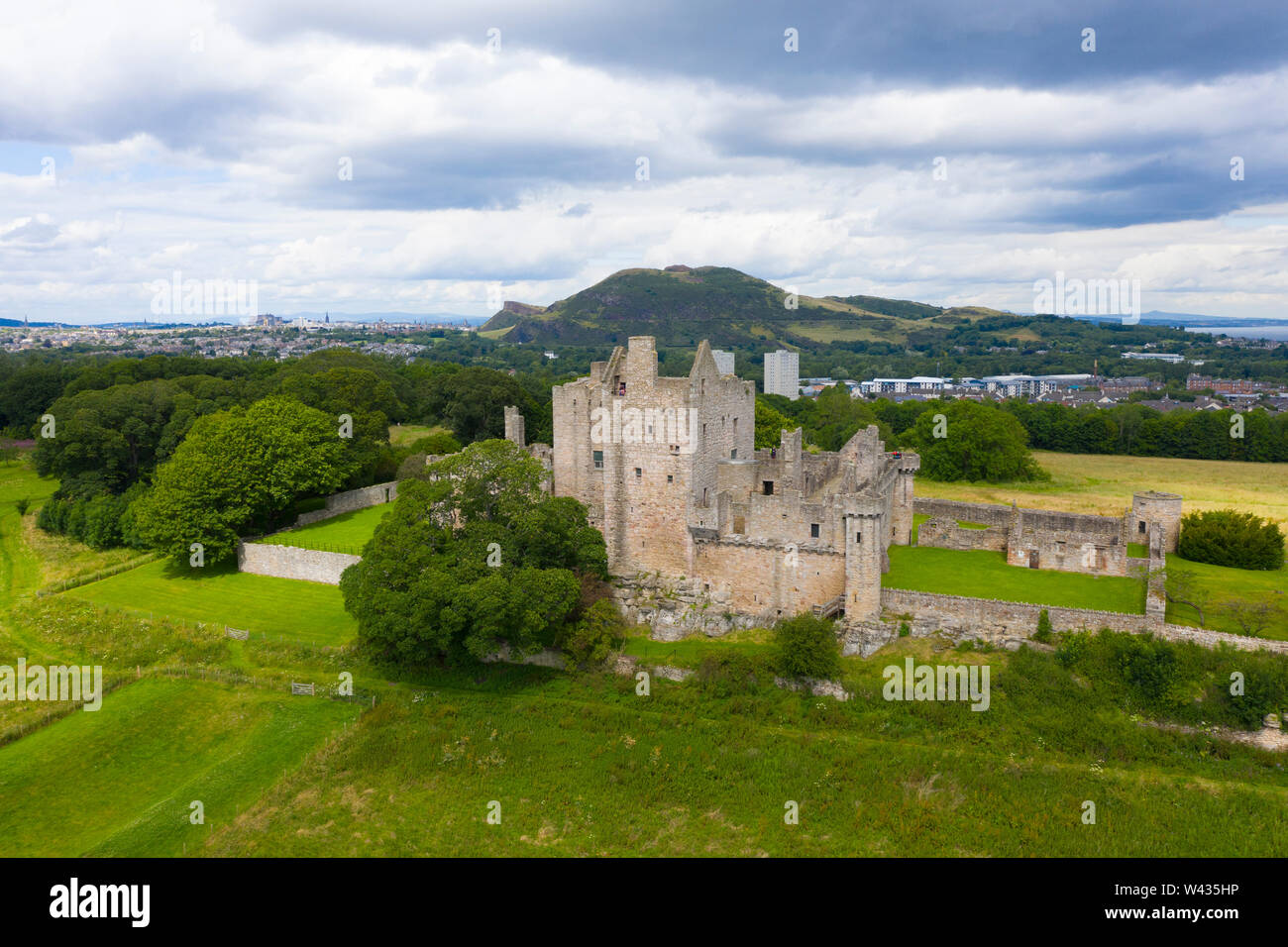 Elevated view of Craigmillar Castle and skyline of Edinburgh, Scotland UK. Stock Photo