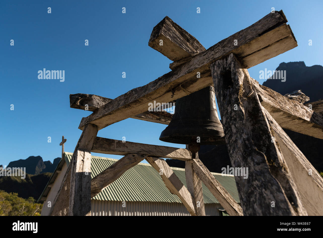Catholic church and separate wooden bell tower in Marla village, early morning light. Caldera of Cirque de Mafate, La Reunion Stock Photo