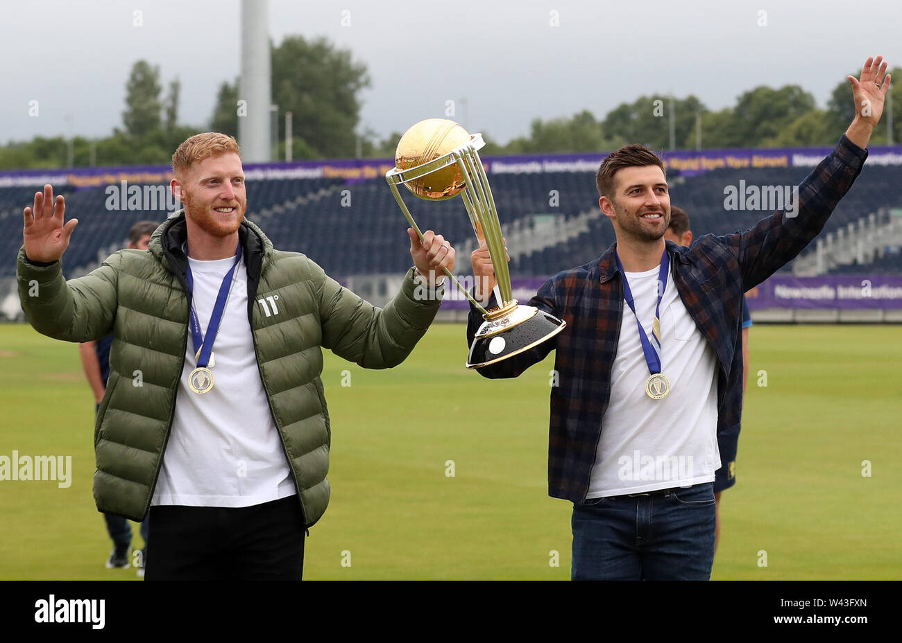 Ben Stokes (left) and Mark Wood celebrate with Cricket World Cup ahead of the Vitality Blast T20 match at Emirates Riverside, Durham. - Stock Image