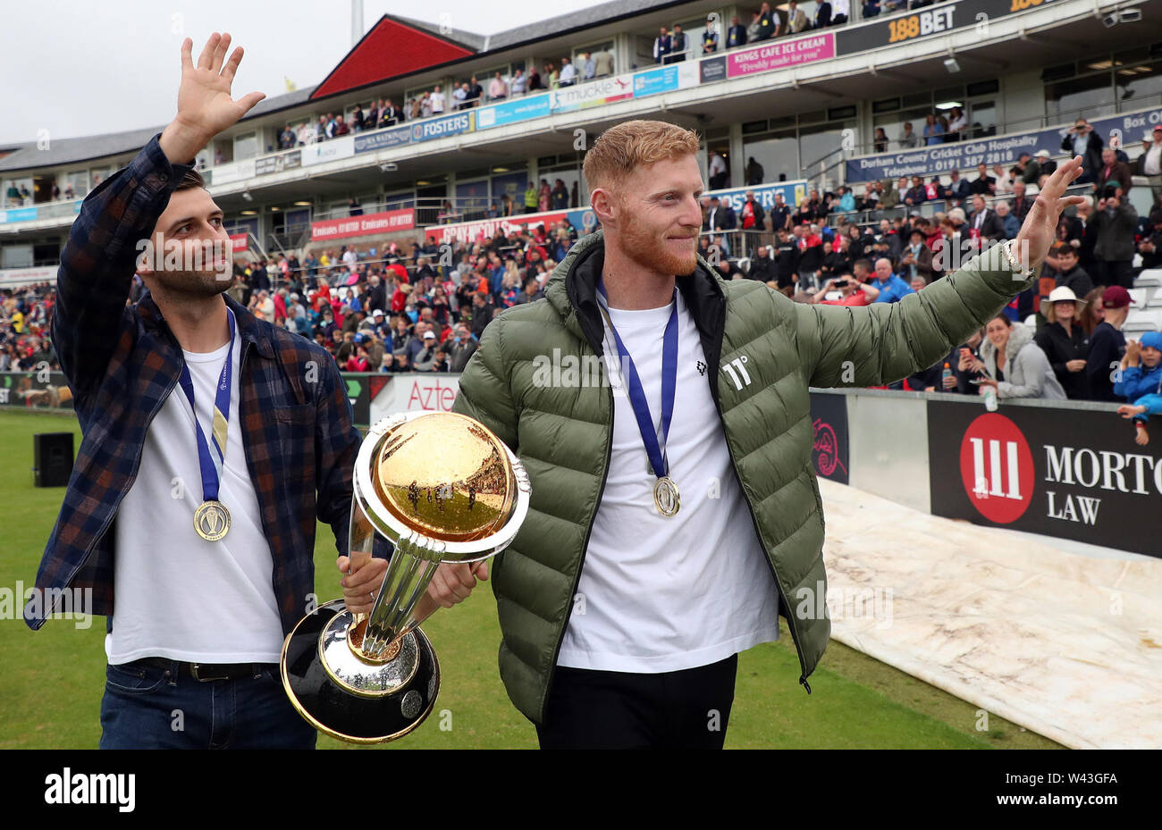 Ben Stokes (right) and Mark Wood celebrate with Cricket World Cup ahead of the Vitality Blast T20 match at Emirates Riverside, Durham. - Stock Image