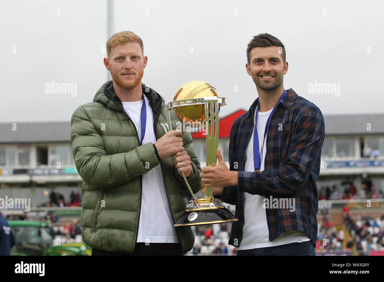 CHESTER LE STREET, ENGLAND 19th July 2019. 2019. England and Durham cricketers Ben Stokes and Mark Wood pose with the Cricket World Cup during the Vitality T20 Blast match between Durham County Cricket Club and Northamptonshire County Cricket Club at Emirates Riverside, Chester le Street on Friday 19th July 2019. (Credit: Mark Fletcher   MI News ) Credit: MI News & Sport /Alamy Live News - Stock Image