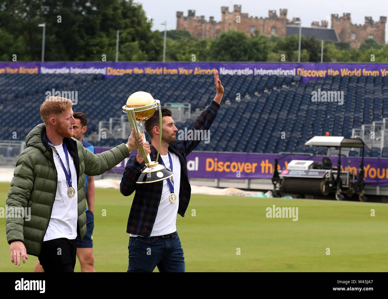 Ben Stokes (left) and Mark Wood celebrate with the Cricket World Cup trophy ahead of the Vitality Blast T20 match at Emirates Riverside, Durham. - Stock Image